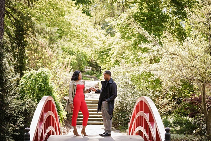 engagement photo on red bridge